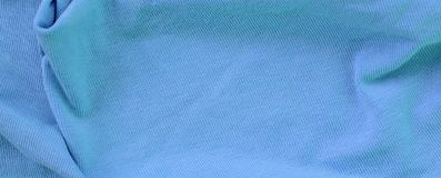 The texture of the fabric in blue color. Material for making shirts and blouses.  royalty free stock image
