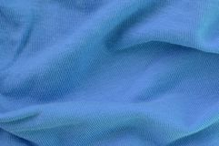The texture of the fabric in blue color. Material for making shirts and blouses.  stock image