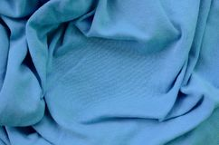 The texture of the fabric in blue color. Material for making shirts and blouses.  royalty free stock images