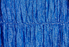 The texture of the fabric. Texture of bright blue fabric with metallic fibers Stock Photos
