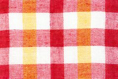 Texture of fabric with a bright checkered pattern. Christmas. Scrapbooking. Napkin, knitting, eyelets, Stock Photography