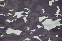 Texture of fabric with a camouflage painted in colors of the marsh. Army background image. Textile pattern of military camouflage vector illustration