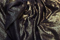 Crumpled shiny fabric. The texture of the fabric. royalty free stock photos