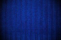 Texture fabric of dark blue color. horizontal. Background a texture a knitted fabric elastic band of dark blue color stock images