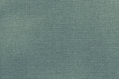 Texture fabric of dark green color. Woven texture of new fabric or cotton material for a background or for wallpaper of dark green color Royalty Free Stock Image