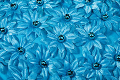 Texture with fabric flowers Stock Images