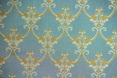 The texture of the fabric, large pattern yellow on green background royalty free stock photos