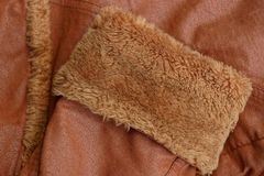 Texture of a fabric made of brown sleeves with fur and leather. On clothes Stock Photo