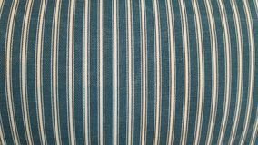 Texture of a fabric of a pillow, sofa, bed, background. Close up, striped, blue and white vertical lines. Royalty Free Stock Photo