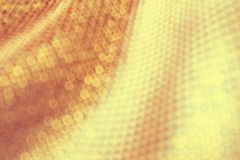 Texture of the fabric, side, background of fabric in the highlight. golden color royalty free stock photo