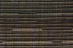 A close up of woven synthetic material texture; beige and brown natural colours, background image. stock photos