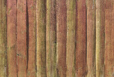 Texture fence red brown and green weathered. Old fence planks green and brown background Royalty Free Stock Photos