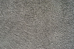 Texture of a fine-grained plaster. Texture of a grey fine-grained plaster on the concrete wall royalty free stock photography