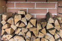 Stacked woodpile. Texture of the firewood. Stacked woodpile Royalty Free Stock Image
