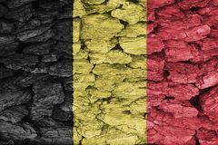 Texture of the Flag of Belgium. Texture of the Flag of Belgium on a decorative tree bark Royalty Free Stock Photo