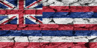 Texture of the Flag of Hawaii. Texture of the Flag of Hawaii on a decorative tree bark royalty free stock image