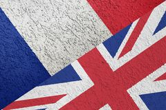 The texture of the flags of France and the UK on the wall of plaster. stock image
