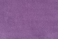 Texture fleece fabric purple, close-up. Abstract background and texture for design Stock Photography