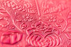 Flower stamping on red leather. Texture of flower stamping on red leather Stock Images