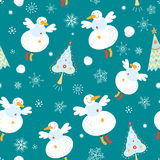 Texture flying snowmen. Seamless pattern of flying snowmen and Christmas trees on a blue background with snowflakes Royalty Free Stock Images