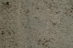 Texture focalisée d'asphalte d'ombre foncée sur la route Photographie stock libre de droits