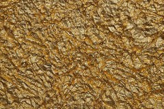 Texture of foil. Texture of wrinkled gold foil paper Stock Photography