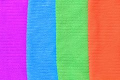 The texture of four colored towels purple, blue , green, orange. stock photos