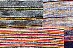 Texture of four various carpets handmade on hand-loom with colorful vertical lines Royalty Free Stock Photos