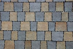 Texture of a fragment of colored square paving slab on the road Royalty Free Stock Images