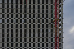 Texture of fragment of a modern Iron-concrete wall with windows without glass. Facade of new multi-storey buildings Royalty Free Stock Photo