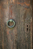 Texture: fragment of old wooden door with hardware elements Stock Photo