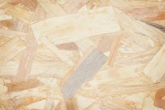 Texture fragment of a plate waste wood,plywood abstract background,natural patterns recycling. Close up Texture fragment of a plate waste wood,plywood abstract royalty free stock image