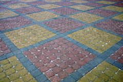 Texture of a fragment of a square old paving slab on the road Royalty Free Stock Photos