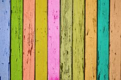 The texture of a fragment of a wooden gate with colored boards stock image