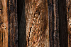 fresh dark wooden boards are arranged vertically Royalty Free Stock Image