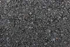 Texture of fresh hot black asphalt is laid on the new road. Stock Photo