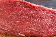 Texture of fresh raw beef meat on wooden table.  Royalty Free Stock Photos