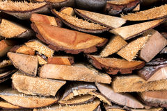 Texture of freshly chopped wood planks stacked in pile Stock Photo