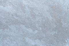 Texture of  frozen icy winter window pane. Winter background. Textured pattern of frozen ice on winter window pane Stock Image