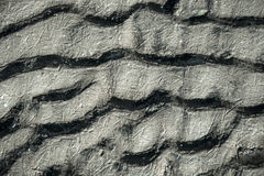 The texture of frozen sand. Wavy texture of frozen sand lying on the banks of the river royalty free stock photography