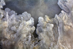 Texture  of frozen water with small waves of blue Stock Photos