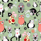 Texture of funny cats. Seamless pattern of bright funny cats on green background Royalty Free Stock Photography