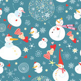 Texture funny snowmen. Seamless pattern of funny snowmen on a blue background with snowflakes Stock Image