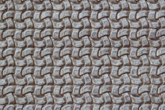 Texture of genuine Braided leather close-up. Fashion trend leather background in grey color, copy space, substrate Royalty Free Stock Photography