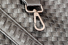 Texture of genuine dark wicker leather close-up and clasp, buckle of male handbag. Concept of shopping, manufacturing Stock Photo