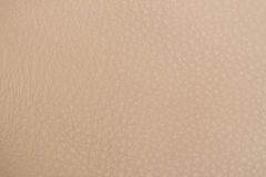 Texture of genuine leather close-up, cowhide, background. Hazelnut Royalty Free Stock Image