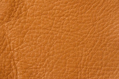 Texture of genuine leather close-up, cowhide. For natural, artisan backgrounds, backdrop, substrate composition use. Texture of genuine leather close-up, cowhide Stock Photos