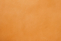 Texture of genuine leather close-up, cowhide, orange, for background , backdrop, substrate use. Stock Photo