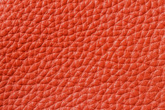 Texture of genuine leather close-up, cowhide, orange. For natural, artisan backgrounds, backdrop, substrate composition Stock Photos