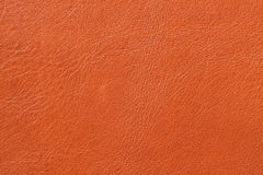Texture of genuine leather close-up, cowhide, orange. For natural, artisan backgrounds, backdrop, substrate composition Stock Photo